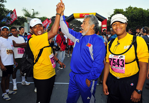 "Xanana Gusmao, the Prime Minister of Timor-Leste high fives Cmdr. Veronica Armstrong during the ""Marathon for Peace"" race."