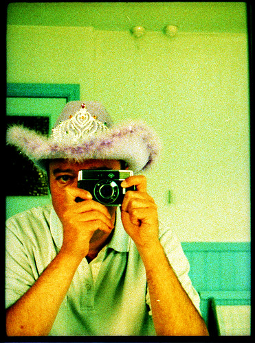 reflected self-portrait with Agfa Parat-I camera and pink cowboy hat by pho-Tony