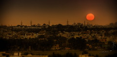 Urban Sunset (Like The Ocean) Tags: sunset sun india canon photography iso100 mar photo dusk bangalore photoblog karnataka hdr xsi sathya sunscape f6 2011 3xp 168mm 05sec