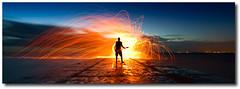 Electric Dawn (Stuart Addelsee) Tags: wool fire wire glow guitar sparks canoneos7d2011stupiestuartaddelseetidewaterseabeachbeachmerejettypierboatrampoceanskycloudsundawnearlywindybrisbanequeenslandaustraliasigma1022mmwide silhouetteel