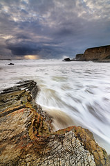 Fury - Panther Beach, Santa Cruz, California (Joshua Cripps) Tags: california sunset santacruz storm clouds america nikon waves crash tripod cliffs textures rush davenport drama mayhem fury crepuscularrays manfrotto pounding godbeams acratech ballhead pantherbeach d300s