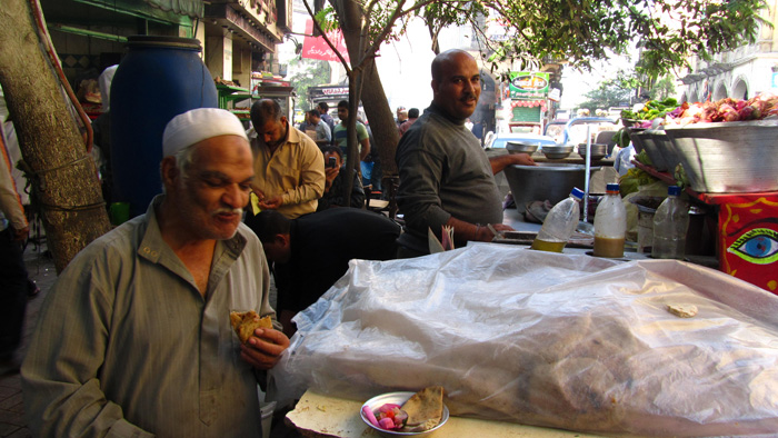 Man Eating Ful Medames in Egypt