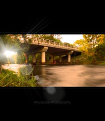 The River Crossing (rhyspope) Tags: longexposure bridge sun lake plant tree green nature wet water grass creek canon river flow stream afternoon bright australia lagoon richmond filter nd flare railing aussie nepean hawkesbury hawkesburyriver 500d yarramundi nepeanriver naturaldensity rhyspope