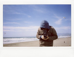 ocean beach life (cindyloughridge) Tags: oceanbeach doublecappuccino fujiinstax210wide itwashurricanewindsthatday imnotevenexaggerating sandeverywhereyouturned istillhavesandinmyshoes everywhereitellya withhisrolleithecameranotourcat