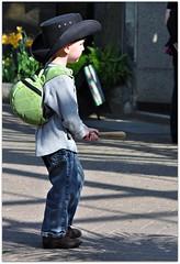 Little Cowboy (Stella Blu) Tags: stella boy hat child blu candid fromtheside littlecowboy nikkor105mmf28gvrmicro nikond5000 pregamesweepwinner theduelpregamesweepwinnersonly pregameduelwinner candidchildnobabies