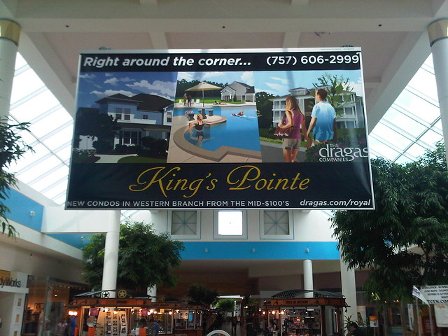 Dragas Companies King's Pointe Quads Announcement Artwork - Center Court Banner at Chesapeake Square Mall