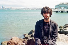 On The Rocks (Gimme Some Salt) (emibell) Tags: sanfrancisco california portrait color minolta shoreline ontherocks sausalito yashica scomas cfp sanfranciscoskyline colorfilm 2011 sanfranciscosummer yashica12 viewofsanfrancisco jasonlester colorfilmphotography viewfromsausalito emibell