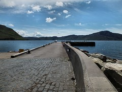 Inverie pier extending into Loch Nevis