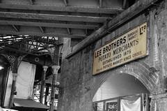 LEE BROTHERS (kaaasch) Tags: old england bw brown london nikon market alt board schild gb sw braun 1855 nikkor markt mauer bogen tafel wass schwarzweis leebrothers nikkor1855 d5100 nikond5100 kaaasch