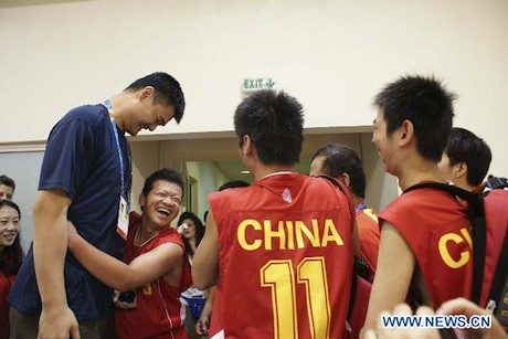 June 26, 2011 - Yao Ming visits with the Chinese Special Olympics basketball team in Athens