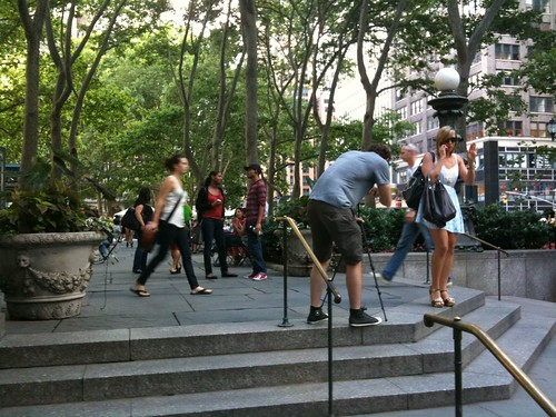 Man filming a woman for a video in Bryant Park