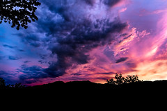 Hurricane Skies (donminer) Tags: sunset brilliant colors clouds sky sun mountais trees moody dark dynamic bluehour beautiful
