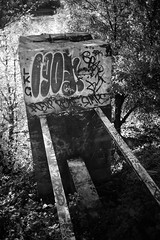 down by the river X (sebboh) Tags: sonya7 rokkormd28mmf2 portland oregon pdx willametteriver graffiti bw cityscape urbex