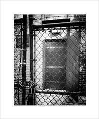 Well, Protected (Explored) (lclower19) Tags: framewithinaframe 4052 522016 wellhouse door fence lock padlock chainlink gate hornpond woburn massachusetts black white bw frame explored