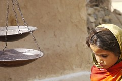 in the balance (handheld-films) Tags: street travel portrait candid indian photojournalism documentary scales balance rajasthan ruralindia asiavillagegirl