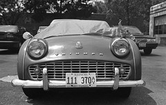 Just a Peek (Triumph TR3) (Fogel's Focus (fueled by coffee)) Tags: thanks 50mm classiccar kodak f14 trix bob olympus 11 d76 triumph evanston zuiko 20c tr3 om1n notraces kodakd76 film:iso=400 930min aristapremium400 developer:brand=kodak developer:name=kodakd76 themiddlekid freestylearistapremium film:brand=freestylearista film:name=freestylearistapremium400 filmdev:recipe=6798