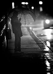 Bus Stop Blues (Donald G. Jean) Tags: shadow italy rain silhouette night umbrella nikon bravo italia noir nikkor notte controluce vicenza d3s donaldgjean 300mmf28ai