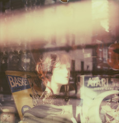 thrift window (davebias) Tags: mannequin polaroid sx70 elmo atari thriftstore shopwindow impossible headinajar polaroidweek