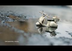 swimming pool (s.f.p.) Tags: travel reflection rain puddle vespa scooter mini streetphoto nano