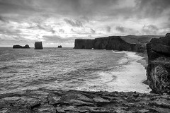 Vik (Kevin. B.) Tags: vik iceland southern region black sand beach waves clouds basalt cliffs puffins columns sea ocean blackandwhite arch cave travel rain sonynex7