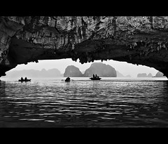 enter the world of the unknown.. (PNike (Prashanth Naik)) Tags: sea sky people bw water boats bay blackwhite nikon rocks asia long kayak hills vietnam ripples ha mystic halong halongbay rockformation d3000 pnike yahoo:yourpictures=blackandwhite