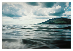 the water | 1 (jessthespringer) Tags: blue ireland sea mountains green texture film water clouds contrast swimming 35mm iso800 kodak carlingford waterproofcamera warrenpoint codown slievefoy autaut jessthespringer lesbrumes