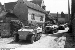 Sd.Kfz. 250 (late) (license number WH-1618921) followed by an Sd.Kfz, 4/1 and three more Sd.Kfz. 250 (late), Flanders, Belgium, June 1944