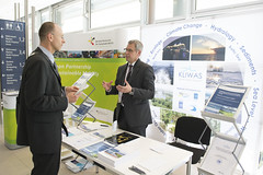 Sebastian Kofalk  discusses with a visitor at the KLIWAS stand