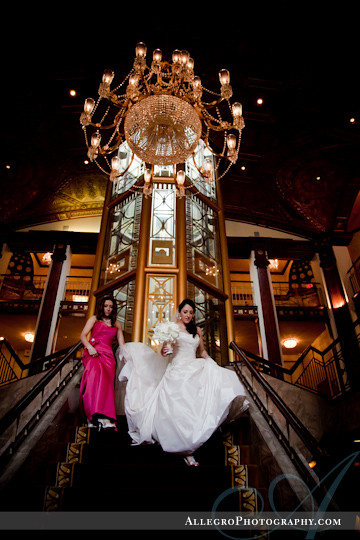 greek-wedding-spring-providence-ri- bride and her sister walk down grand staircase at providence biltmore hotel
