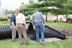 Installing the drain. (cosiscience) Tags: cosi outdoorgarden centerofscienceandindustry bigmachines picnicpark