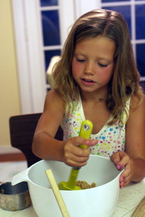 Niece stirring strawberry white blondies