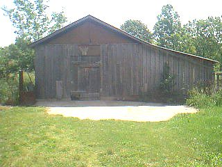 Garage sized shed with riding mower that stays