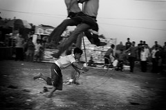 Gaining Momentum (Satyaki Basu) Tags: people india festival canon eos village indian swing 1750 tamron bengal bnw bangla westbengal explored 450d charak gettyimagesmiddleeast