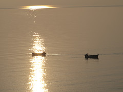 Boats Passing at Sunrise (David R. Crowe) Tags: nature sunrise boat europe pattern object atmosphere places greece vehicle peacefulness zakinthos attributes reflectionpattern