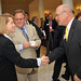 Tina Wilson of IBM (left) greets President and CEO of the Greater Raleigh Chamber of Commerce Harvey Schmitt (right).