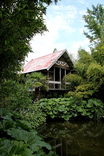 wooden house in garden close to lake