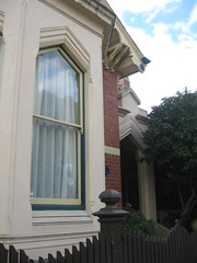 """Clowance"", a Late Victorian Villa - Ballarat (raaen99) Tags: city windows brown house building tree brick home window leaves stone architecture facade fence garden painted name cement 19thcentury decoration entrance australia victoria carving porch victoriana woodenfence villa historical residence canopy housename nationaltrust roofline eaves gable ballarat goldrush picket 1893 portico redbrick entranceway ornamentation nineteenthcentury picketfence 1890s 1892 sashwindow countryvictoria vestibule baywindow gardenfence domesticarchitecture victorianera heritagelisted newelpost clowance gingerbreading goldrushera brickandstone renderedbrick cementrender provincialvictoria boomstyle architecturallydesigned boomstylearchitecture hippedgable clowancehouse isaiahpearce wegribble"