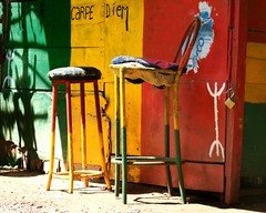 Are you sitting comfortably.. (areyarey) Tags: africa red two green love yellow metal one design couple colorful iron day sitting peace exterior chairs furniture vibrant decorative empty seat style objects morocco simplicity frame seating minimalistic rune seize carpe diem areyarey