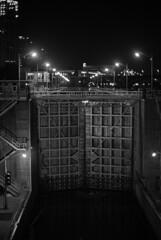 Upper St Anthony Falls Lock (Bolobilly) Tags: city bridge blackandwhite bw minnesota night lowlight industrial dam minneapolis machinery mpls mississippiriver handheld locks twincities mn lockanddam hennepincounty saintanthonyfalls