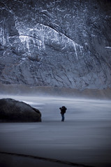Confrontation. (GauthierD) Tags: ocean above winter sea people lake snow mountains cold ice beach nature norway circle landscape frozen sand rocks waves small windy arctic fjord polar lofoten
