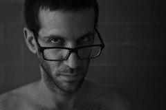 friday selfie (Yakir Pollak) Tags: shadow portrait blackandwhite selfportrait man black glass look closeup self 50mm glasses serious expression shade