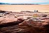 towards Hilbre Island (khrawlings) Tags: red rock wirral dee estuary river coast sea hilbreisland hoylake man boy sitting sand