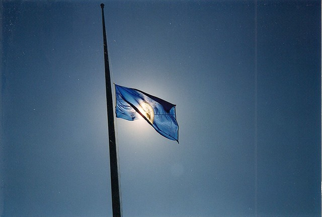 Photograph of a Minnesota state flag flying at half-mast