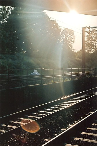 Sun flare on delayed train home by Vespamore !