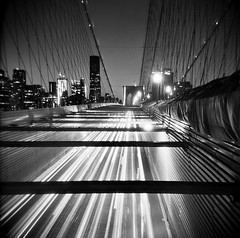 The buzzing sound of the traffic (Jason Lupi) Tags: longexposure trip bridge bw holiday newyork cars 120 6x6 film night america mediumformat square toy lights us holga 120film plastic 400 brooklynbridge hp5 analogue ilford 10seconds withfriends bulbsetting citycsape