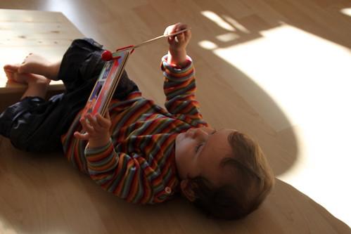 exploring his presents.