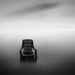 * contemplating * (^soulfly) Tags: longexposure morning beach water mono simplicity minimalistic canongear bestoftheyear honorablementionaward bwnd110 strandedchair photomalaysia4thannualexhibition2011