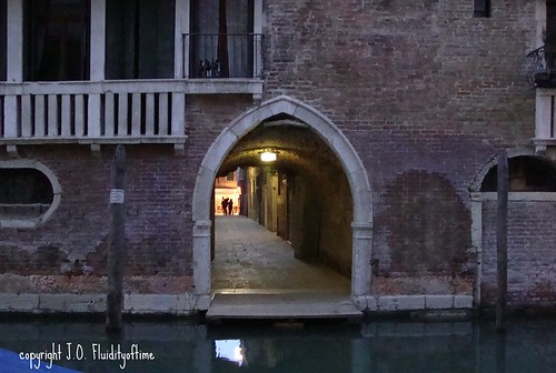 Venice nighttime canal arch