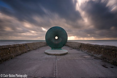(Claire Hutton) Tags: longexposure winter sunset sea sculpture motion blur colour green clouds concrete seaside movement brighton hole empty jetty front le donut doughnut round seafront groyne eastsussex deserted ndfilter brightonandhove 10stop thedoughnut nd110 sonynex5r