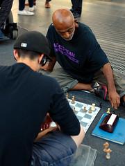 chessmaster (Ian Muttoo) Tags: dsc70331edit toronto gimp ufraw ontario canada yongedundassquare chess player players match street